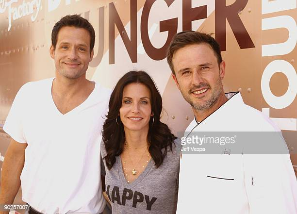 Actors Josh Hopkins and Courteney Cox pose with actor/host David Arquette during the kick off for Hunger Action Month with Feeding America and The...
