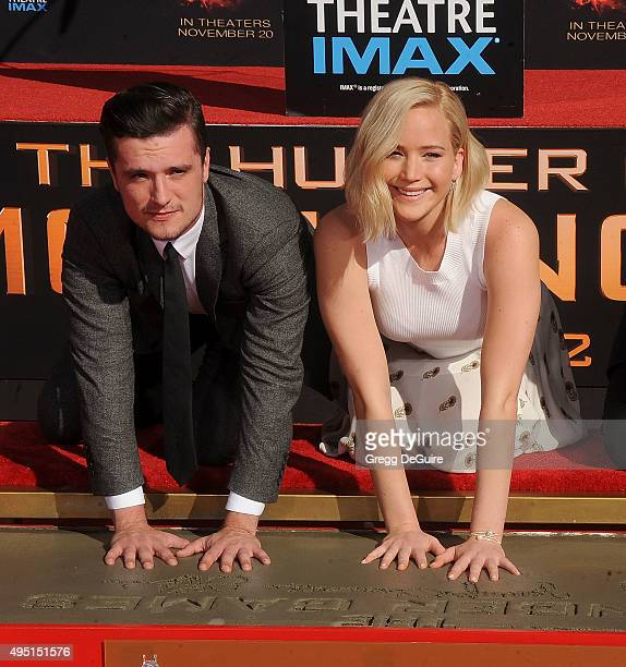 Actors Josh Hutcherson and Jennifer Lawrence pose at The Hunger Games Mockingjay Part 2 Hand And Footprint Ceremony at TCL Chinese Theatre on October...