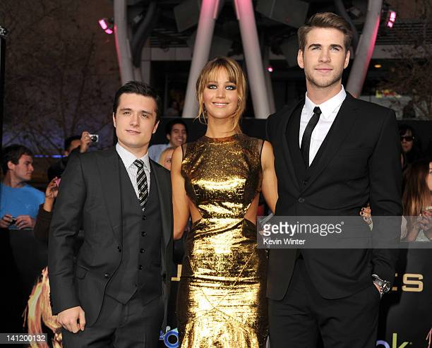 Actors Josh Hutcherson Jennifer Lawrence and Liam Hemsworth arrive at the premiere of Lionsgate's The Hunger Games at Nokia Theatre LA Live on March...