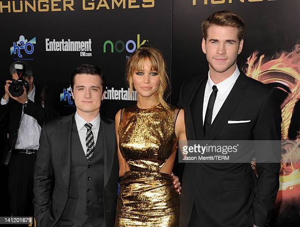 """Actors Josh Hutcherson, Jennifer Lawrence, and Liam Hemsworth arrive at the premiere of Lionsgate's """"The Hunger Games"""" at Nokia Theatre L.A. Live on..."""