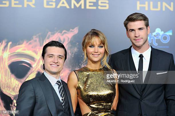 Actors Josh Hutcherson Jennifer Lawrence and Liam Hemsworth arrive to the premiere of Lionsgate's The Hunger Games at Nokia Theatre LA Live on March...