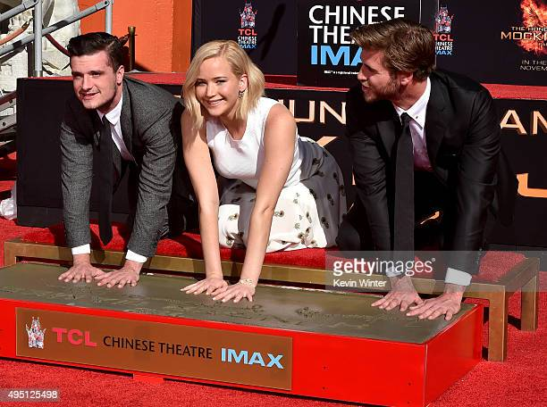 "Actors Josh Hutcherson, Jennifer Lawrence and Liam Hemsworth attend Lionsgate's ""The Hunger Games: Mockingjay - Part 2"" Hand and Footprint Ceremony..."