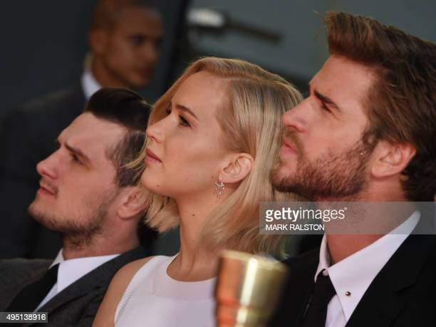 Actors Josh Hutcherson Jennifer Lawrence and Liam Hemsworth attend Lionsgate's 'The Hunger Games Mockingjay Part 2' Hand and Footprint Ceremony at...