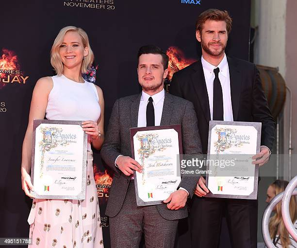 """Actors Josh Hutcherson, Jennifer Lawrence and Liam Hemsworth pose at the Stars From Lionsgate's """"The Hunger Games: Mockingjay - Part 2"""" Hand And..."""