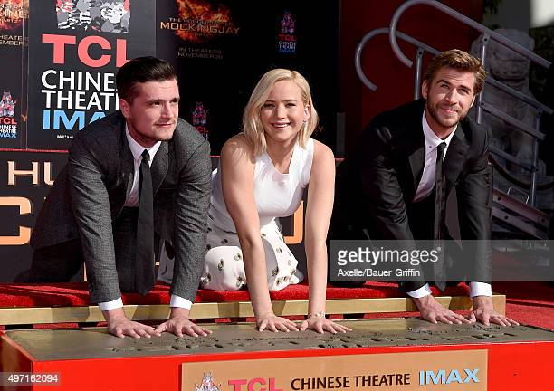 Actors Josh Hutcherson, Jennifer Lawrence and Liam Hemsworth pose at 'The Hunger Games: Mockingjay - Part 2' Hand And Footprint Ceremony at TCL...