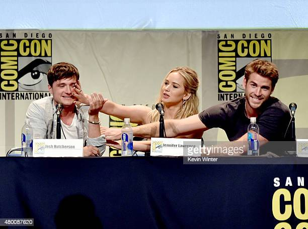 Actors Josh Hutcherson Jennifer Lawrence and Liam Hemsworth speak onstage at the 'The Hunger Games Mockingjay Part 2' panel during ComicCon...
