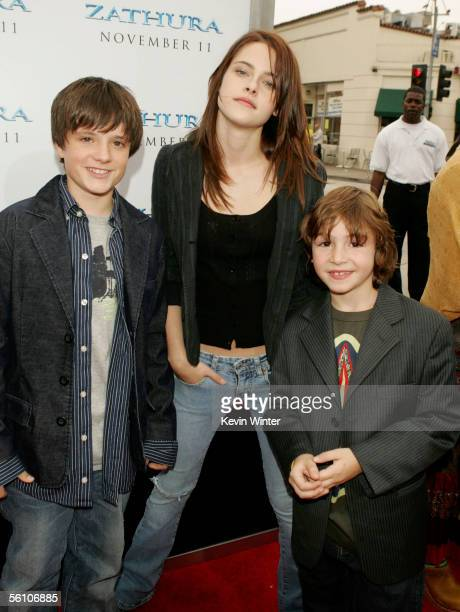 Actors Josh Hutcherson Kristen Stewart and Jonah Bobo pose at the premiere of Columbia Picture's Zathura A Space Adventure at the Village Theater on...