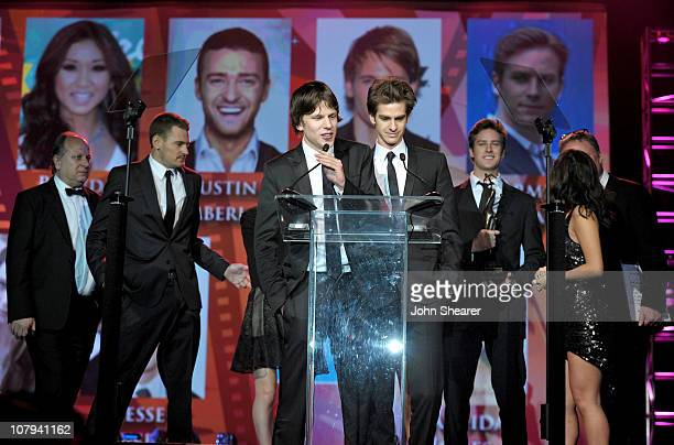 Actors Josh Pence Jesse Eisenberg Andrew Garfield Armie Hammer Brenda Song and director David Fincher accept the Ensemble Performance Award at the...