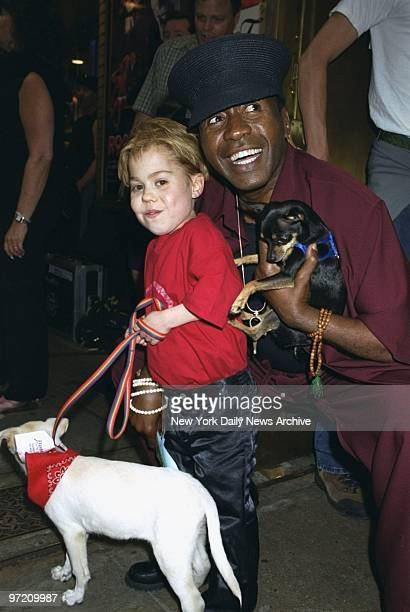 Actors Josh Ryan Evans and Ben Vereen show off some of the pooches up for adoption during the Broadway Barks 3 benefit at Shubert Alley The annual...