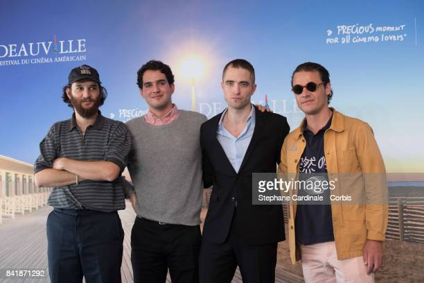 Actors Josh Safdie Robert Pattinson Ben Safdie and Producer Oscar Boyson attend the 'Good Time' Photocall during the 43rd Deauville American Film...