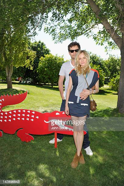 Actors Joshua Jackson and Diane Kruger attend day 1 of LACOSTE LVE Hosts a desert pool party in celebration of Coachella on April 14 2012 in Thermal...