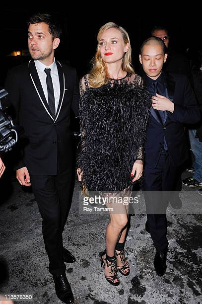 Actors Joshua Jackson Diane Kruger and designer Jason Wu enter the Crown Restaurant on May 2 2011 in New York City