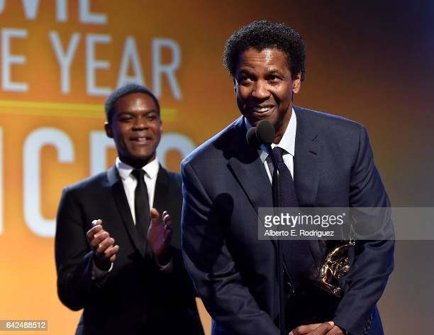 Actors Jovan Adepo and Denzel Washington accept the Movie of the Year Award for 'Fences' onstage during BET Presents the American Black Film Festival...