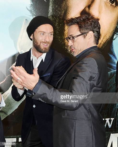 Actors Jude Law and Robert Downey Jr arrive at the European Premiere of 'Sherlock Holmes A Game of Shadows' at Empire Leicester Square on December 8...