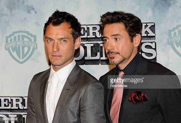 Actors Jude Law and Robert Downey Jr arrive at the premiere of ''Sherlock Holmes'' at Kinepolis Cinema on January 13 2010 in Madrid Spain