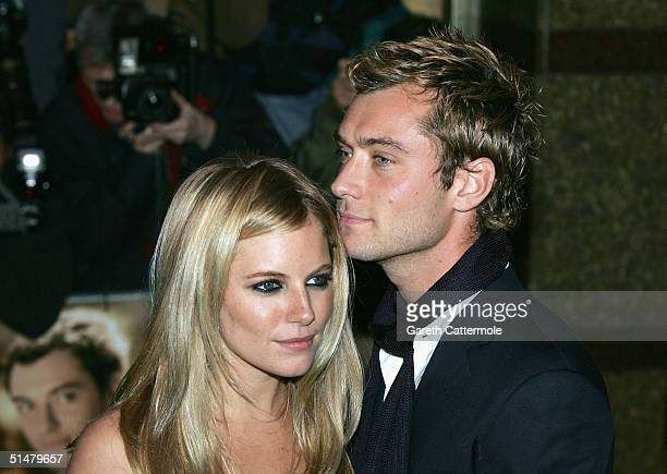 Actors Jude Law and Sienna Miller arrive at the World Premiere of Alfie at the Empire Leicester Square on October 14 2004 in London