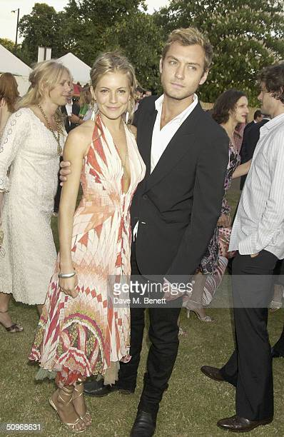 Actors Jude Law and Sienna Miller attend The Serpentine Gallery's annual summer party at the The Serpentine Gallery on June 16, 2004 in London.