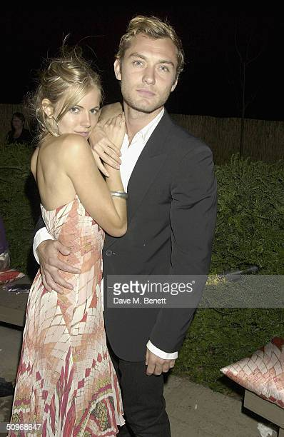 Actors Jude Law and Sienna Miller attend The Serpentine Gallery's annual summer party at the The Serpentine Gallery on June 16 2004 in London