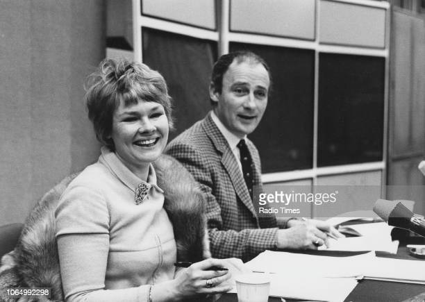 Actors Judi Dench and Edward Woodward pictured reading scripts in front of radio microphones, November 23rd 1970.