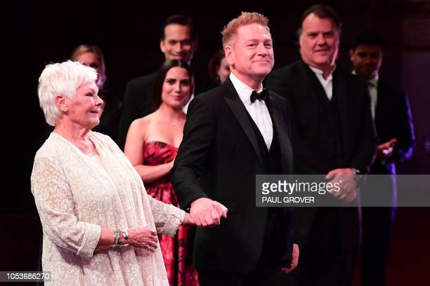 Actors Judi Dench and Kenneth Brannagh take a bow after performing during a gala concert in the Throne Room at Buckingham Palace in London on October...