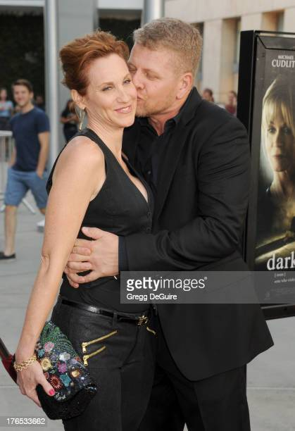 """Actors Judith Hoag and Michael Cudlitz arrive at the Los Angeles premiere of """"Dark Tourist"""" at ArcLight Hollywood on August 14, 2013 in Hollywood,..."""