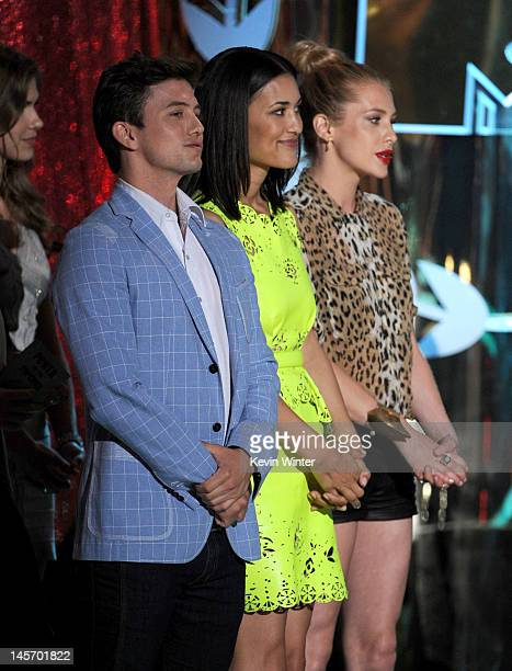 Actors Julia Jones and Jackson Rathbone accept the Best Movie award onstage during the 2012 MTV Movie Awards held at Gibson Amphitheatre on June 3...