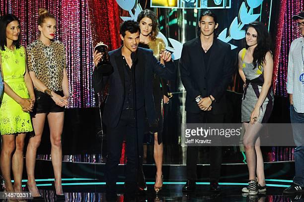 Actors Julia Jones Taylor Lautner Nikki Reed Booboo Stewart and Kristen Stewart speak onstage at the 2012 MTV Movie Awards at Gibson Amphitheatre on...