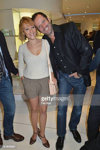 Actors Julia Livage and Christian Vadim attend the Vendanges Montaigne 2012 in the Courreges Shop at Avenue Montaigne on September 11 2012 Paris...