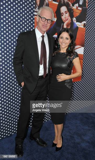 Actors Julia LouisDreyfus and her husband writer Brad Hall attend the Los Angeles premiere for the second season of HBO's series 'Veep' at Paramount...