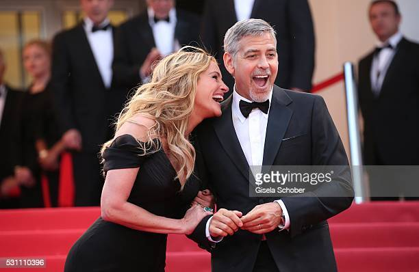 Actors Julia Roberts and George Clooney attend the 'Money Monster' premiere during the 69th annual Cannes Film Festival at the Palais des Festivals...