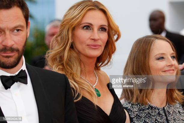 Actors Julia Roberts and Jodie Foster attend the premiere of Money Monster during the 69th Annual Cannes Film Festival at Palais des Festivals in...