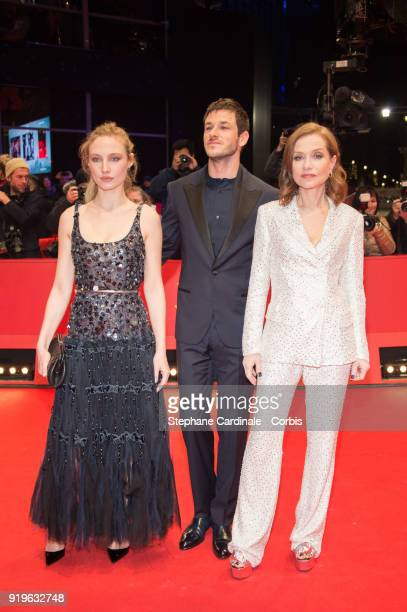 Actors Julia Roy Gaspard Ulliel and Isabelle Huppert attends the 'Eva' premiere during the 68th Berlinale International Film Festival Berlin at...