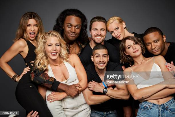 Actors Juliana Harkavy Emily Bett Rickards Echo Kellum Stephen Amell Rick Gonzalez Katie Cassidy Willa Holland and David Ramsey from Arrow are...