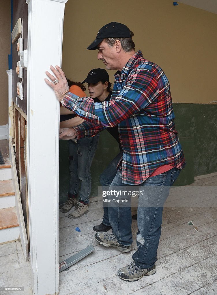 Actors Julianna Margulies and Chris Noth help repair a home as The Cast Of 'The Good Wife' Celebrates Their100th Episode With A Day Of Service For The St. Bernard Projecton on October 26, 2013 in New York City.