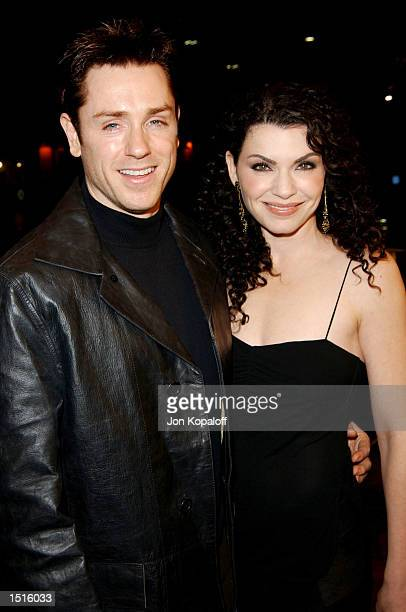 """Actors Julianna Margulies and Ron Eldard attend the premiere of """"Ghost Ship"""" at the Mann Village Theater on October 22 in Westwood, California."""