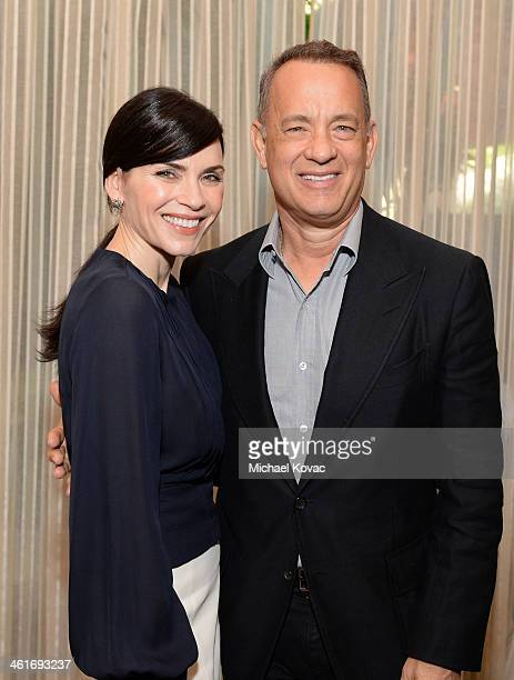 Actors Julianna Margulies and Tom Hanks attend the 14th annual AFI Awards Luncheon at the Four Seasons Hotel Beverly Hills on January 10 2014 in...