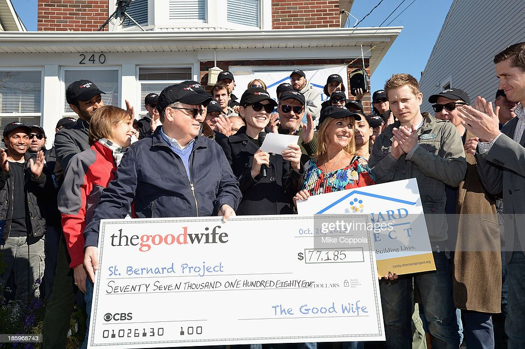 Actors Julianna Margulies, Chris Noth, Archie Panjabi, Matt Czuchry, and Zach Grenier present a check to the St. Bernard Project as The Cast Of 'The Good Wife' Celebrate Their100th Episode With A Day Of Service For The St. Bernard Project on October 26, 2013 in New York City.