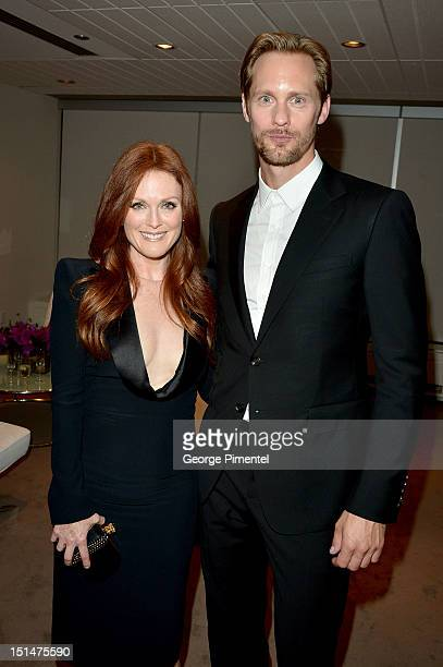 Actors Julianne Moore and Alexander Skarsgård attends 'What Maisie Knew' premiere during the 2012 Toronto International Film Festival at Roy Thomson...