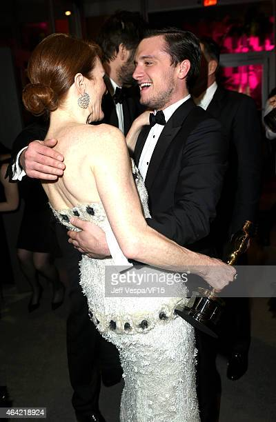 Actors Julianne Moore and Josh Hutcherson attend the 2015 Vanity Fair Oscar Party hosted by Graydon Carter at the Wallis Annenberg Center for the...
