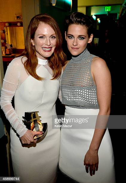 Actors Julianne Moore and Kristen Stewart pose with the Hollywood Actress Award for 'Still Alice' backstage during the 18th Annual Hollywood Film...