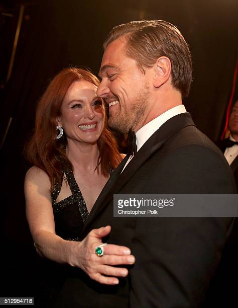 Actors Julianne Moore and Leonardo DiCaprio attend the 88th Annual Academy Awards at Dolby Theatre on February 28 2016 in Hollywood California