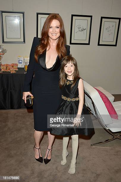 Actors Julianne Moore and Onata Aprile attend What Maisie Knew premiere during the 2012 Toronto International Film Festival at Roy Thomson Hall on...
