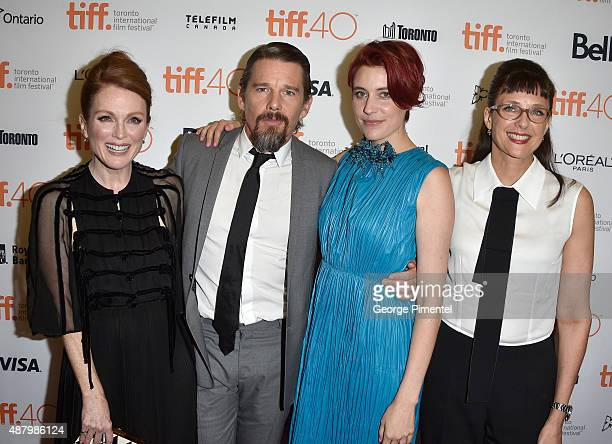 Actors Julianne Moore Ethan Hawke Greta Gerwig and director/screenwriter Rebecca Miller attend the Maggie's Plan premiere during the 2015 Toronto...