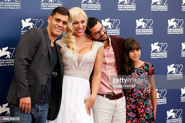Actors Juliano Cazarre Abigail Pereira director Gabriel Mascaro and Alyne Santana attend a photocall for 'Neon Bull' during the 72nd Venice Film...