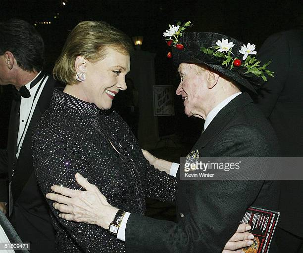 Actors Julie Andrews and Red Buttons talk at the afterparty for Disney's Mary Poppins 40th Anniversary Edition DVD Launch party and screening at...