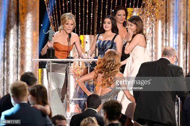 Actors Julie Bowen Ariel Winter Sarah Hyland Sofia Vergara and Ed O'Neill accept the Outstanding Performance by an Ensemble in a Comedy Series award...