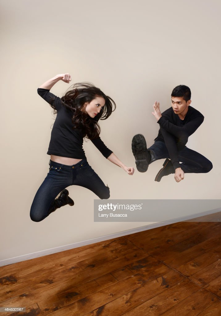 Actors Julie Estelle and Iko Uwais pose for a portrait during the 2014 Sundance Film Festival at the Getty Images Portrait Studio at the Village At The Lift Presented By McDonald's McCafe on January 22, 2014 in Park City, Utah.
