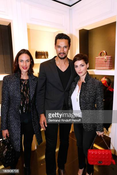 Actors Julie Fournier Stany Coppet and Clemence Thioly attend 'Vogue Fashion Night Out 2013' at Dior Rue Royale in Paris on September 17 2013 in...