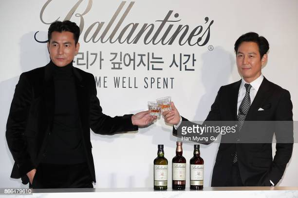 Actors Jung WooSung and Lee JungJae attend the Pernod Ricard Korea Ballantine's Time Well Spent campaign photocall on October 26 2017 in Seoul South...