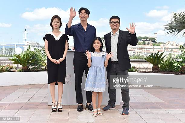 Actors Jung Yumi Gong Yoo Kim Suan and director Yeon Sangho attend the Train To Busan photocall during the 69th Annual Cannes Film Festival on May 14...